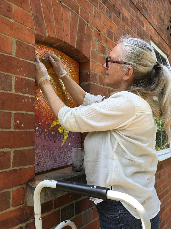 installing golden birds mosaics