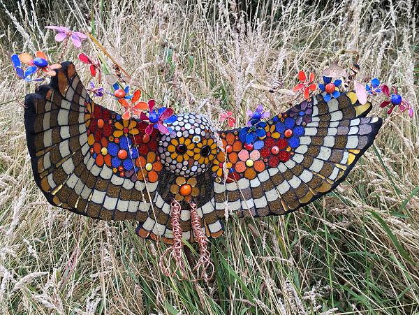 Flower face owl landing