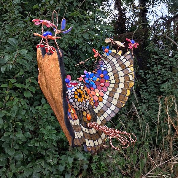 flying owl sculpture